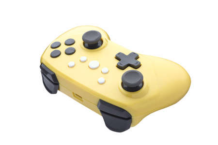 Retro video game gamepad. Yellow controller for a video game. Gamepad isolated on a white background. Full depth of field. Standard-Bild