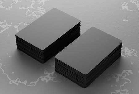 Mockup of paper business cards folded in two piles on an old stone background. 3D rendering.