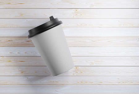 mock-up of a paper mug that lies on a wooden table. 3d rendering