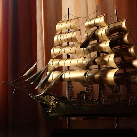 Collectible ship figurine in gold color. art. ship model. High quality photo
