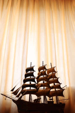Collectible ship figurine in gold color. art. ship model. High quality photo 免版税图像