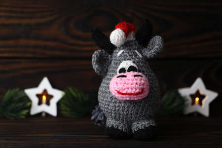 New year bull on dark background. Knitted christmas bull. Handmade symbol of the year 2021. High quality photo
