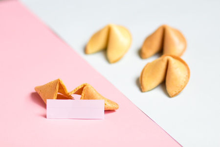 fortune cookie on pink and blue background, pastel colors