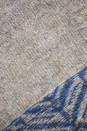 the texture of a knitted sweater, close up warm woollen clothing