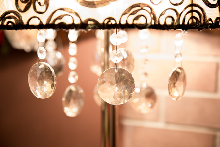 Chrystal chandelier close-up in the dark. Glamour background Stock Photo