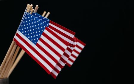 Miniature paper flag USA. American Flag on black background. Reklamní fotografie