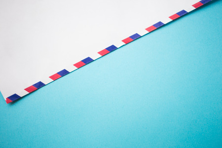 air mail envelope letter on blue background