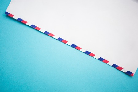 air mail envelope letter on blue background, copy space