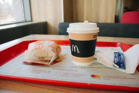 Moscow, Russia - 11 18 2018: Hamburger menu in McDonald's restaurant, coffee, cheeseburger. Fastfood and junk food