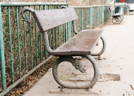Prague, Czech Republic - 04 02 2013: View of the streets of Praha. Vintage empty bench