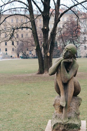 Prague, Czech Republic - 04 02 2013: Architecture, buildings and landmark. sculpture of a girl sitting on the stone