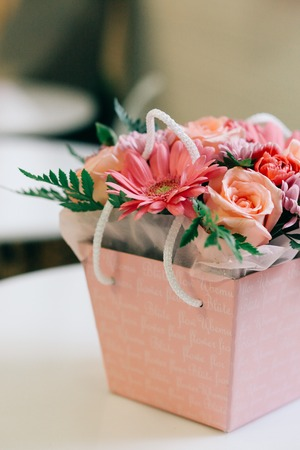 Beautiful flowers bouquet in a pink box, valentine gift concept
