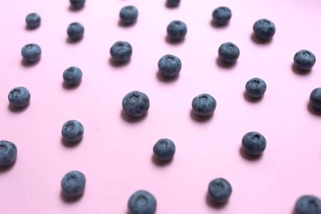 Blueberry pattern on pink background top view