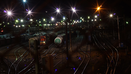 The photo image Commodities at night station. View from the bridge. Station Floodlights
