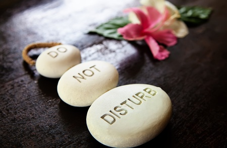 meditative: Stones with a sign Do not disturb Stock Photo