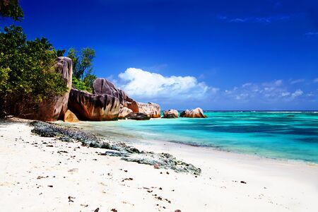 best travel destinations: One of the best beaches in the world beautiful Anse Source dArgent Stock Photo