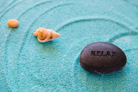 Stones and shell on a blue sand, sea and relax collection, zen, meditation,  spa photo
