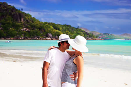 honeymooners: Couple kissing and hugging on a beach Stock Photo