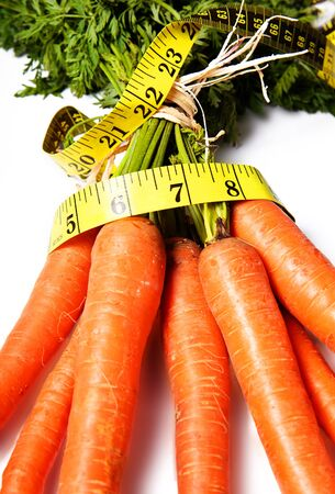 Banch of carrots with waist measurement photo