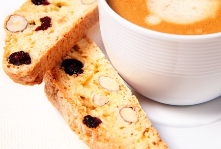 Closeup biscotti with cup of coffee photo