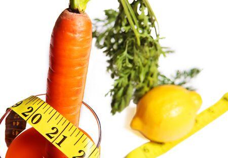 Carrot, lemon and measurement tape Stock Photo - 10932198
