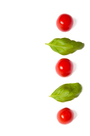 abstract art vegetables: Cherry tomatoes and  basil with copyspace on a white background