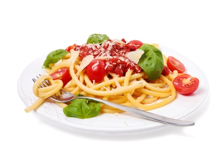 Italian pasta with tomato sauce, fresh cherry tomatoes, basil isolated Stock Photo