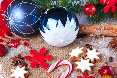 blue christmas balls with cookies and spices on a burlap photo