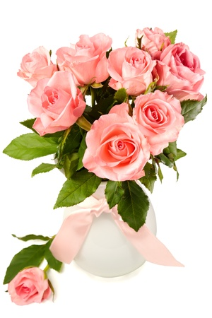 Bouguet of pink roses in a white vase photo