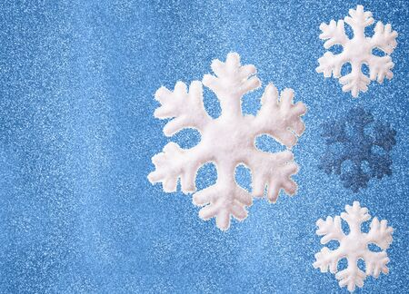 Snowflakes on a blue sparkling background photo