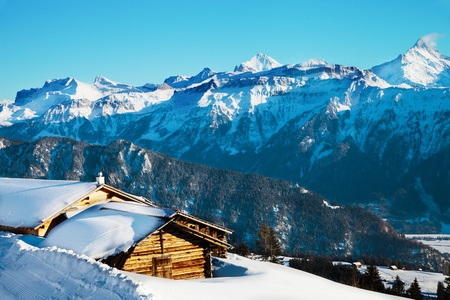 wooden houses with a perspective of swiss alps