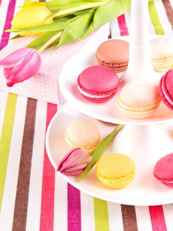 tiered: Colorful variety macaroons with tulips Stock Photo
