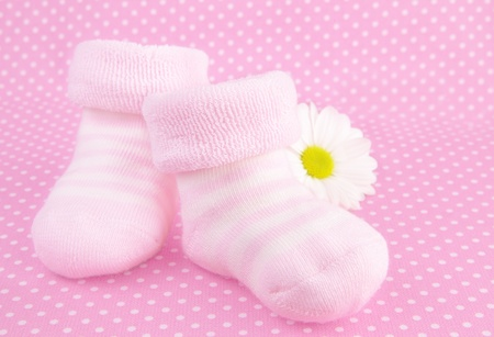 baby shoes: Pink baby girl knitted socks or shoes - gift for newly-born child Stock Photo