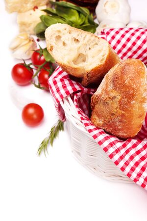 Fresh homemade baguette with fresh cherry tomatoes, and herbs photo
