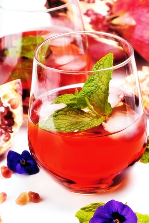 Fresh pomegranate juice with peppermint photo