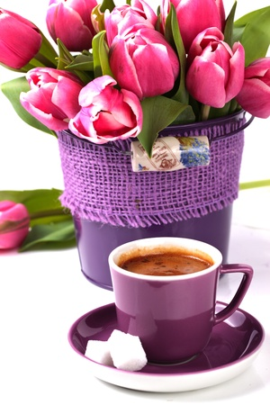 Morning cup of espresso with pink  tulips photo