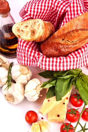Fresh homemade baguette with olive oil, parmesan and cherry tomatoes photo