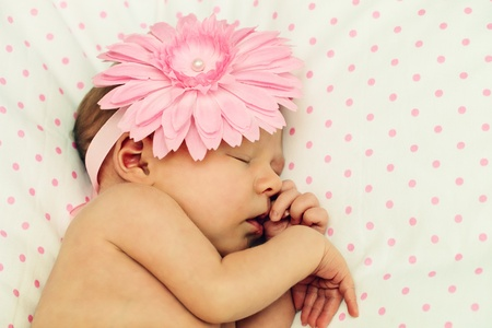 Adorable, sweet girl with fflower headband photo