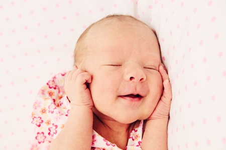 Sleeping and smiling cute and funny baby girl Stock Photo - 13396457