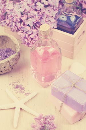 Spa concept - soap, pink essential oil, lilac, bath salt and starfish photo