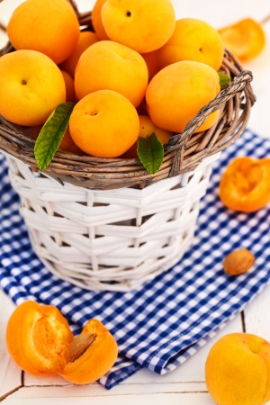 Fresh apricots in the basket Stock Photo - 13605043