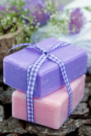 Liliac and pink soap over wood. photo