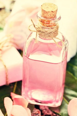 Essential Oil for Aromatherapy, with rose petals and soap photo