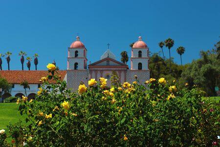santa barbara: The historic Santa Barbara Mission in California with beautiful roses garden in front Stock Photo