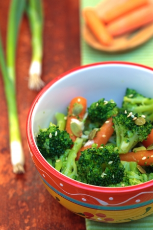 Steamed, seasoning vegetables - broccoli with baby carrots  Vegetarian dish  Stock Photo