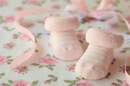 Pink shoes for newly born baby girl photo