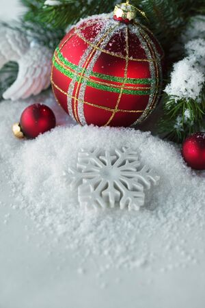 Christmas red balls with snow and branch of pine. Stock Photo - 15423372
