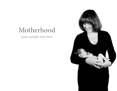 Happy mother holding new born baby  Studio shot, black and white effect photo
