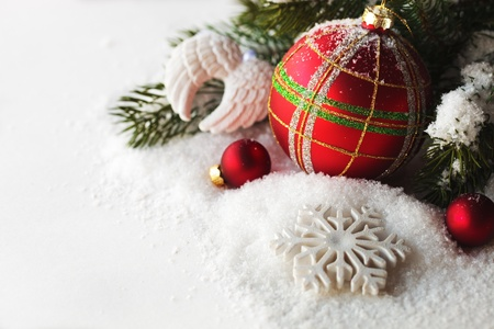 Christmas red ball - decoration on a white background with snow and branch of pine Stock Photo - 15655638