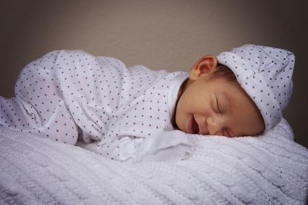 sleepwear: Newborn baby boy sleeping with pajamas